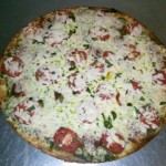 Slice-Into-This-Get-Your-Serving-of-Pizza-from-Franklin-Restaurants-e1435031855776